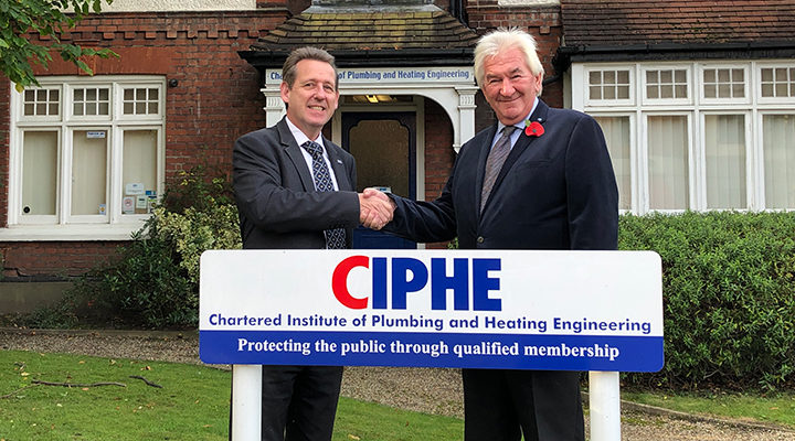 Kevin Wellman and Peter Thom shaking hands outside CIPHE