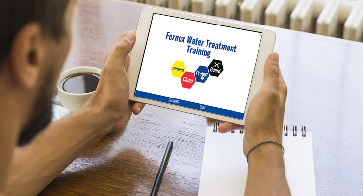 Someone accessing Fernox Water Treatment Training from their tablet