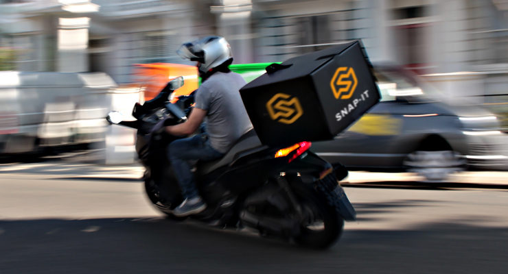A motorbike with the Snap-It logo
