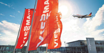 An image of Viessmann's head office with a plane flying overhead