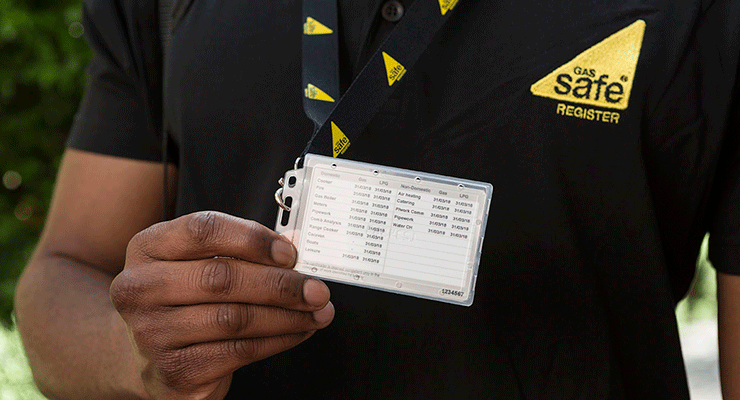 Gas engineer showing his Gas Safe ID card