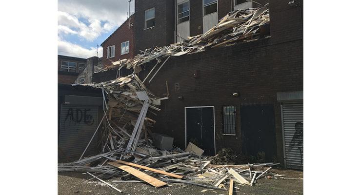 Asbestos and building materials strewn on refurbishment site