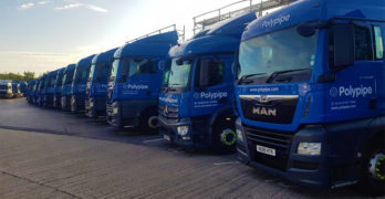 A row of parked lorries with Polypipe logos
