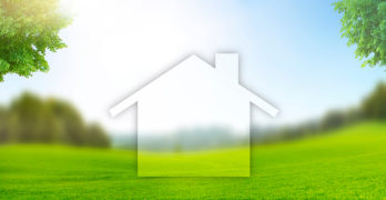 Image of a house in green countryside