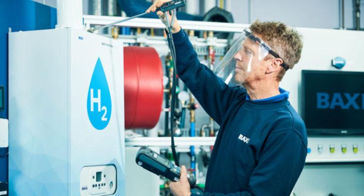 Engineer in front of hydrogen boiler